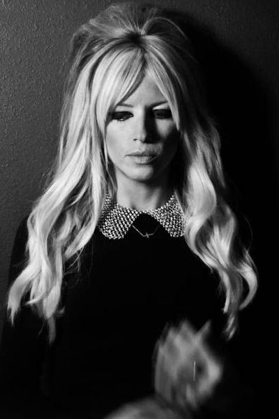 Make like Brigitte Bardot and tease long hair at the crown for a glamorous retro effect.