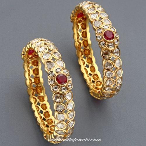 Gold bangles with precious stones