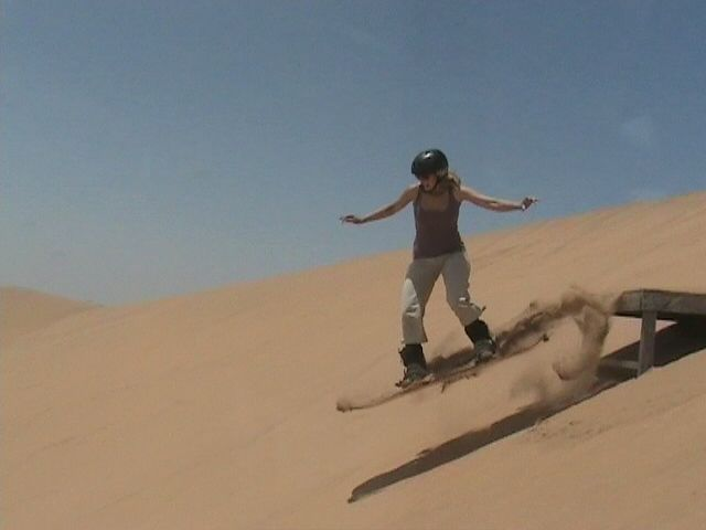 """Dohop User hopping on a """"sandboard"""" in Namibia  www.dohop.com"""