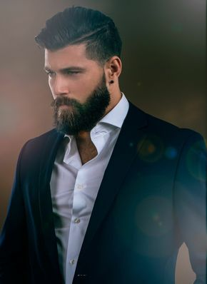 The complete look - suit, shirt, hair, piercing blue eyes, hairy chest, smooth skin and beard.  Handsome is as handsome does.