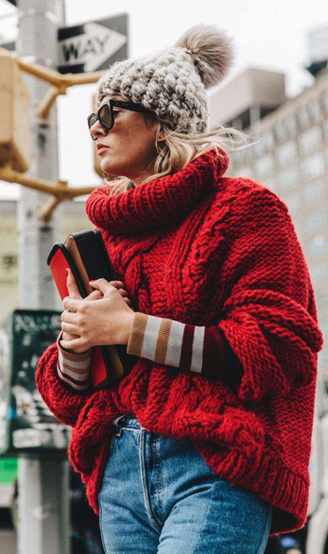 Layer your knits, and finish your look of with an oversized knit hat.