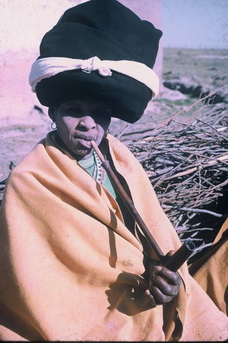 Africa | A Xhosa woman smoking her traditional Xhosa pipe. Eastern Cape - Transkei. South Africa. | Lister Haig Hunter.