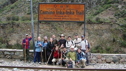 Trekking the Inca Trail - Group posing in front of sign. #peru #hiking #Machu #Picchu