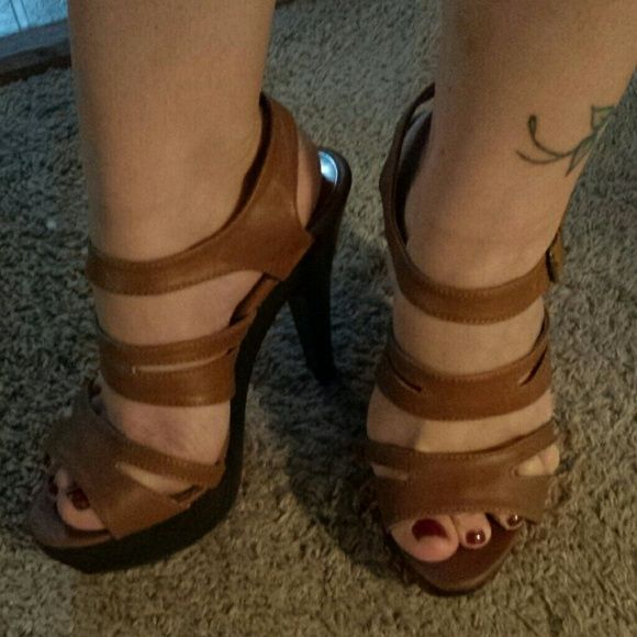 Strappy heels Light brown strappy heels with a dark brown faux wood heel & platform. Heel is about 3.5 inches, platform about 1.25 inches. Beautiful on, only worn once. Fit true to size Shoes Heels