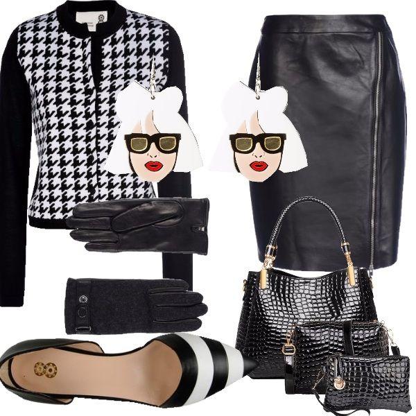 Look dalle linee decise e dai colori bianco e nero adatti alla donna senza sfumature. Outfit comodo per l'ufficio e per un viaggio di lavoro con la borsa effetto coccodrillo con pochette abbinate per il make up e tutto quello chele serve per essere al top.