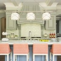 Kitchen: Another example of how to add a pop of color in the neutral kitchen by simply upholstering the chairs.  www.oharainteriors.com