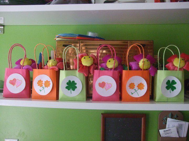 Carebear themed party treat bags. Too cute.