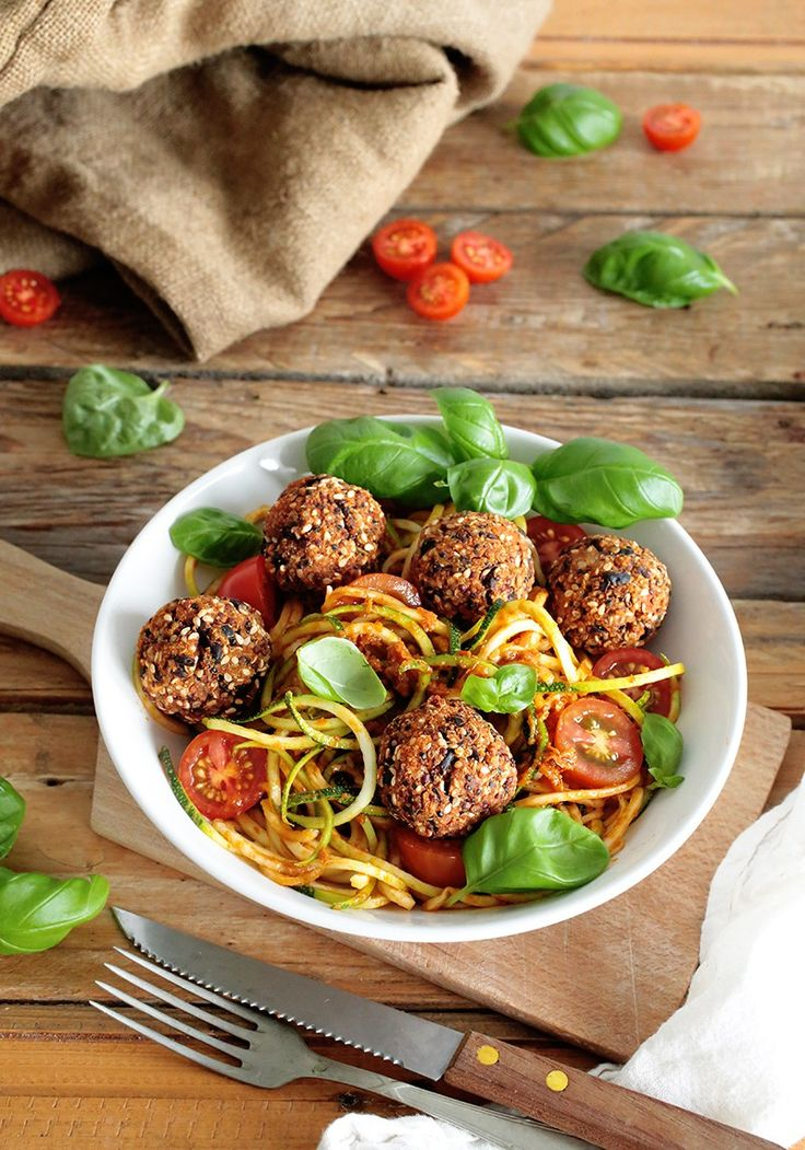 Crispy vegan Black Bean and Quinoa Balls with spiralized zucchini and a delicious sun-dried tomato sauce. Gluten-free + oil-free