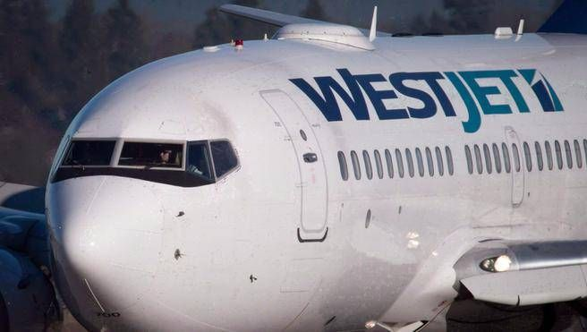 A pilot taxis a Westjet Boeing 737-700 plane to a gate after arriving at Vancouver International Airport. (THE CANADIAN PRESS / File)