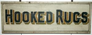 """Hooked Rugs Trade Sign  Vermont, Ca. 1920     Colorful 2-sided pine sign with applied molding. Unusual subject matter in a period sign.     38"""" wide x 13"""" high x 1 3/4"""" deep.       SOLD"""