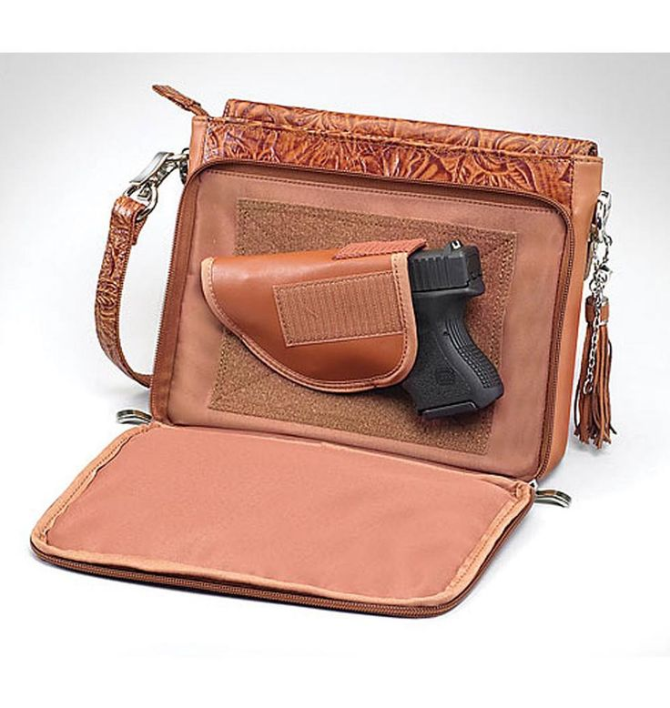 Concealed Carry Purse - Tooled American Cowhide- love this one!  so hard to find a smaller clutch/wallet. This place has some cute but functional ones. so glad my range turned us on to them.