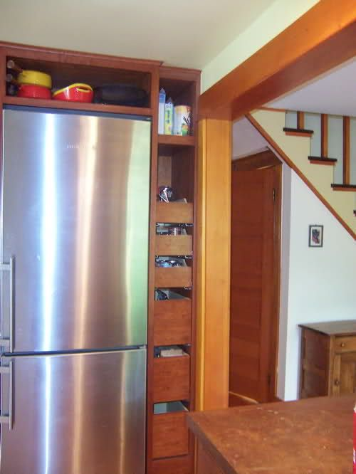 awesome pull-out drawers beside the fridge for extra ...
