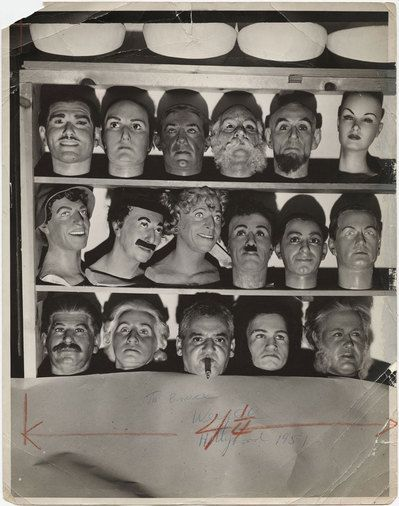 Weegee (Weegee, the cigar chomping photographer — aka Arthur Fellig) among the wax faces of Hollywood, 1951.    Photos: Weegee/International Center of Photography/Getty Images By