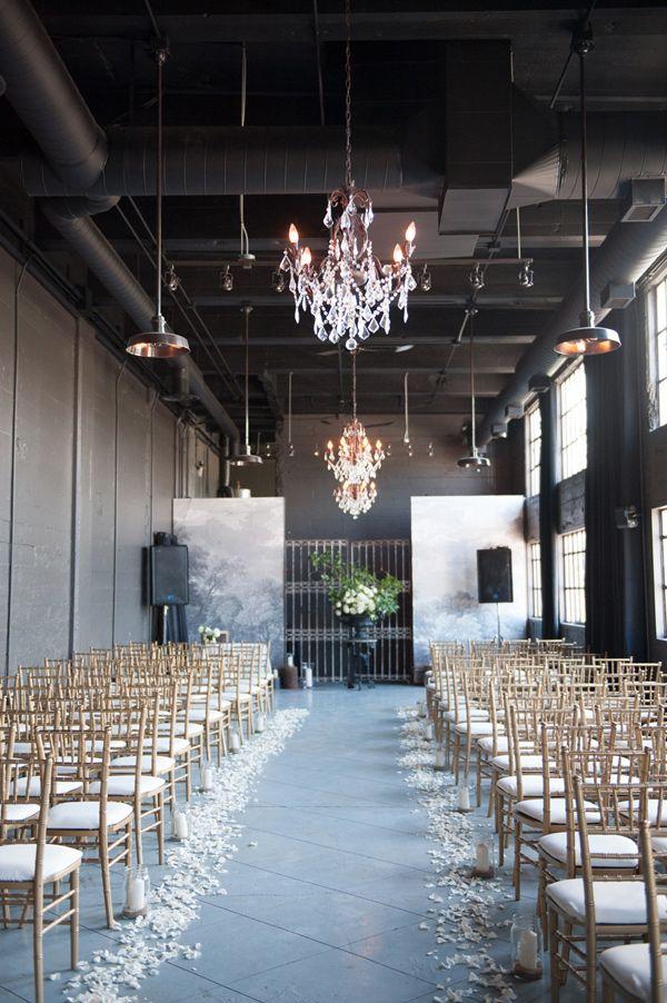 elegant industrial ceremony space, photo by Jarusha Brown http://ruffledblog.com/black-gold-calgary-wedding #wedding #ceremony #industrial
