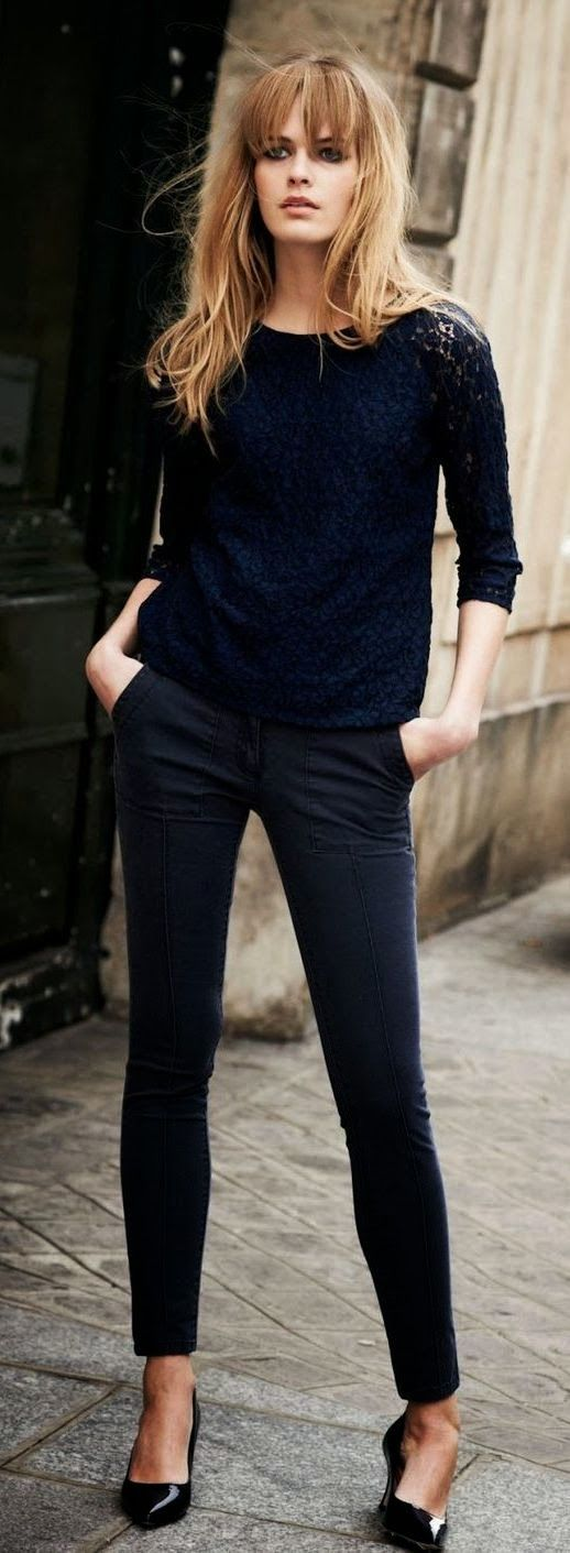 A monochrome outfit, especially in a dark hue, is a little-known trick for portraying a powerful, I-can-do-this attitude at work without have to don a suit. The best way to do it is combining different textures, like she does here with a patent leather shoe, cotton pants, and a lace top.
