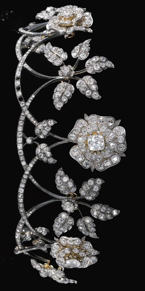 An antique diamond tiara, late 19th century. Designed as a graduated series of swags each surmounted alternatively with floral and foliate motifs, set with cushion-shaped, circular-cut and rose diamonds, inner circumference approximately 250mm, each floral and foliate motif detachable, accompanied by five brooch fittings, a few small diamonds deficient, case stamped Raff. Fecarotta & Co. #antique #tiara