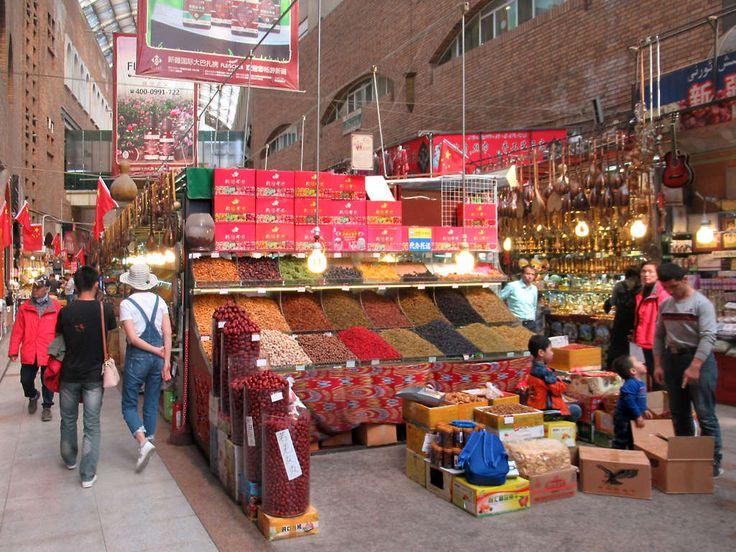 The Erdaoqiao Market and Grand Bazaar in Urumqi, Xinjiang, China, presents a colorful scene.