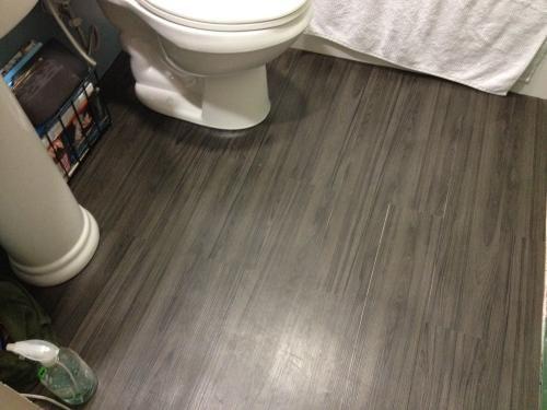39 best images about flooring on pinterest for Best vinyl for bathrooms