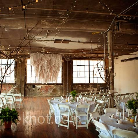 it was an easy transition between the ceremony and reception: Ceremony chairs faced the windows, while simple white tables were set up just behind them.
