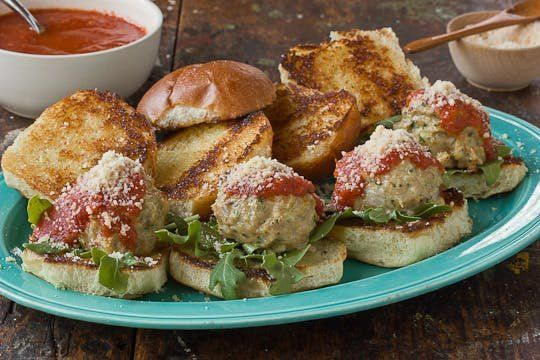 Chicken & Mozzarella Meatballs Sliders Recipe. Better and more unique than your typical oven baked ham and cheese sliders or ground beef hamburgers recipes. Use any kind of dinner rolls you like (kings hawaiian are nice). You'll need ground turkey or chicken, whole milk, egg, bread crumbs, garlic, shallots, string cheese, tomato sauce and mozzarella cheese. This is perfect if you're looking for ideas for dinners or meals or small appetizers and bites for the holidays or new years eve!