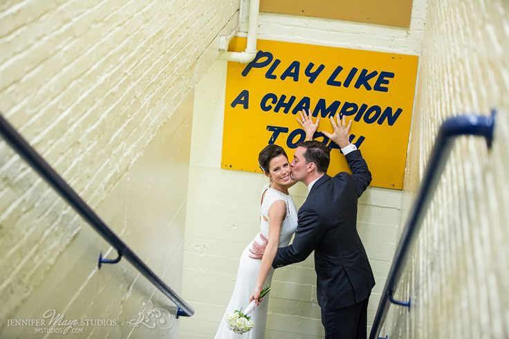 "Amie and Mark's University of Notre Dame wedding photos in the Fighting Irish locker room at the Notre Dame Football Stadium ""Play Like a Champion Today"" 
