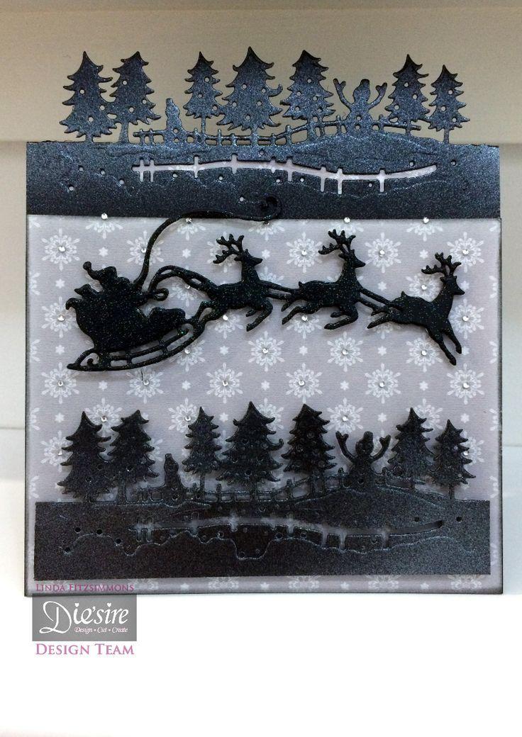 Linda Fitzsimmons - Die'sire Christmas Garden Edge'able - Santa's Sleigh Christmas Classiques - Matt Black card - Sara Davies Signature Collection Festive Wonder 6x6 paper - Pearl Diamond Spray and Sparkle - Irridescent Spray and Sparkle - Collall All Purpose Glue, Tacky Glue, 3D Glue gel - Gems - #crafterscompanion #Christmas