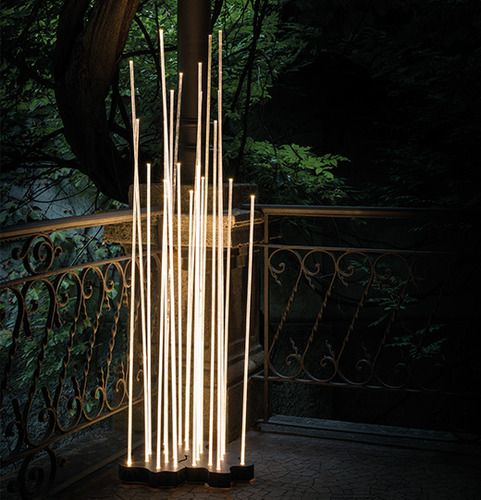 Inspired by nature, the Artemide Reed LED Floor Lamp features 7 transparent rods that capture the warmth of the integrated LEDs. A stunning outdoor lighting statement.