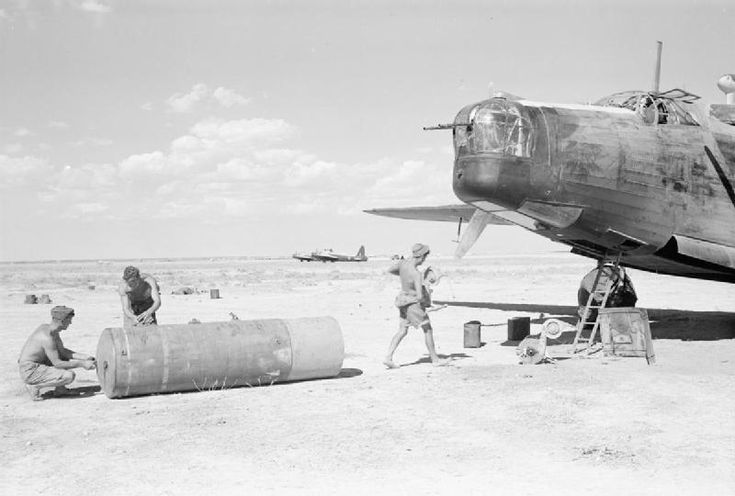 "Armourers fuzing a 4,000-lb HC bomb (""Cookie"") at Kairouan West, Tunisia, before loading it into a Vickers Wellington Mark X of No. 205 Group RAF, during preparations for a night bombing raid on Salerno, Italy, prior to the Allied landings at there, (Operation AVALANCHE). Date 1943"