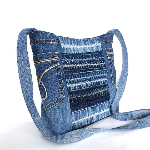 I constructed this light weight and practical crossbody bag from retired blue jean pants. You will find two of original pockets on sides of the