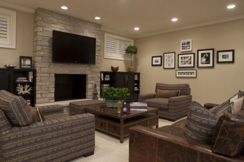TV above fireplace with lots of seating