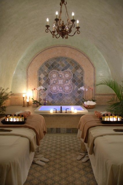 home spa room with lighted soaking tub and twin massage tables