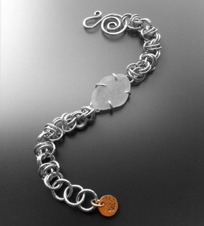 Seaglass chainmaille bracelet - love the prong setting for the seaglass!