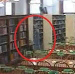 ghost photo from willard library  Indiana- cool thing about this, is that there is a live ghost cam where you can watch and save photos of the lady in grey or children in the children's room. The history on this library is also amazing.