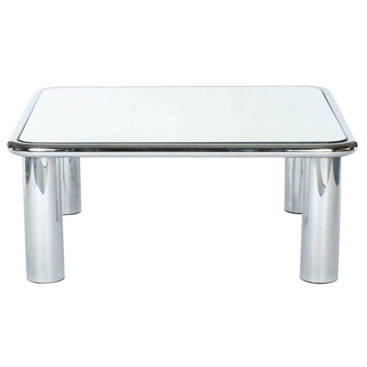 Designer byMARIO BELLINI Produced byC&B ITALIA  Chrome and mirror coffee or cocktail table designed in the 1970s. Rounded-edge design in elegantMinimalist form.  SIZE Lenght: 90cm Width: 90cm Height: 39cm  STOCK 1 Available