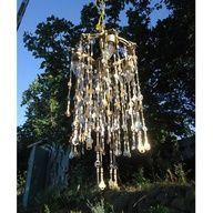 I bet I have a pretty good start on making one of these from the old keys in the junk drawer!  Lost Key Chandelier Windchimes