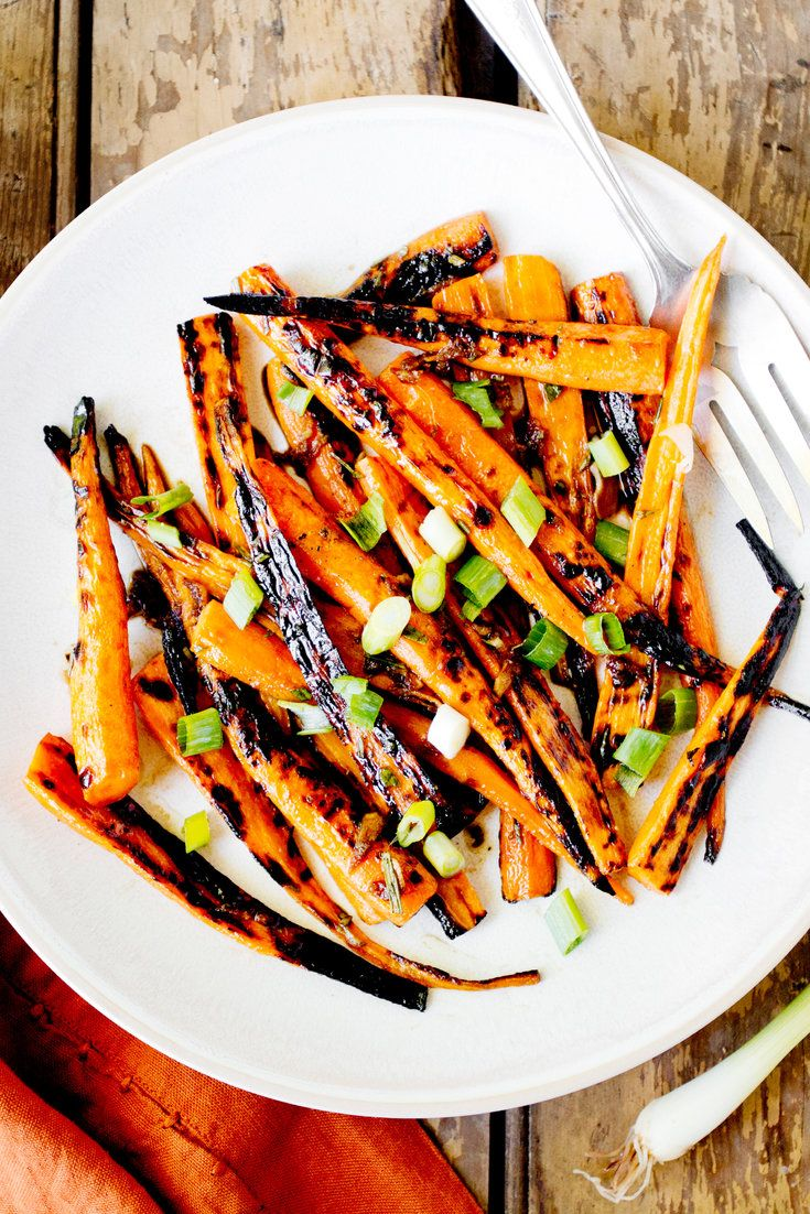 NYT Cooking: These glazed carrots, from Karen and Quinn Hatfield of the Los Angeles restaurant Odys and Penelope, are caramelized and sweetened from a quick hot turn on the grill, then tossed in a salty dressing of soy sauce, balsamic vinegar, garlic and ginger. Turning the carrots often and moving them around on the grill keeps them from burning. And if your carrots are burning bu...