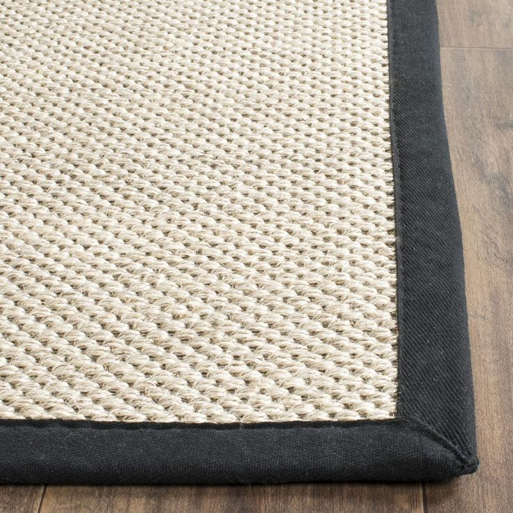 NF143A Rug from Natural Fiber collection.  This casual area rug is made using innately soft and durable natural fiber yarns, with subtle, organic patterns created by a dense sisal weave. Room decor takes on a warm, homey aspect with the distinctive look and comforting feel of this natural fiber floor covering.