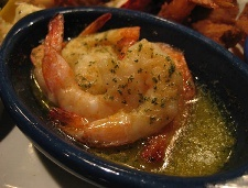 1 cup white wine 1/2 cup unsalted butter, melted 3 tablespoons minced garlic 1 pound shrimp, peeled and deveined Paprika Parsley flakes Mix the wine, butter and garlic together and pour over the shrimp. Sprinkle with paprika and parsley flakes. Bake in a 350 degree F oven for about 6 to 7 minutes. Be careful not to overcook the shrimp. The shrimp is done when it has turned pink.