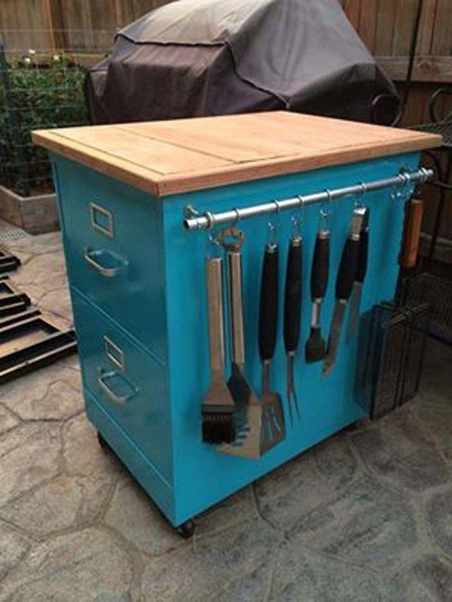 Turn an old filing cabinet into a rolling kitchen cart. Mike needs this for grilling and I have the file cabinet!