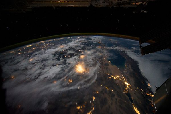 City lights shine through the clouds in an astronaut's view of southern California and Mexico's Baja California snapped from the International Space Station (ISS) in August.