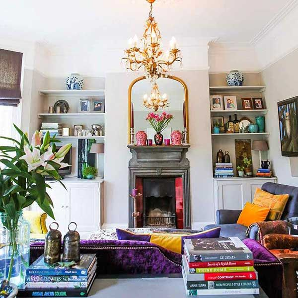 white living room with brightly coloured feature accessories