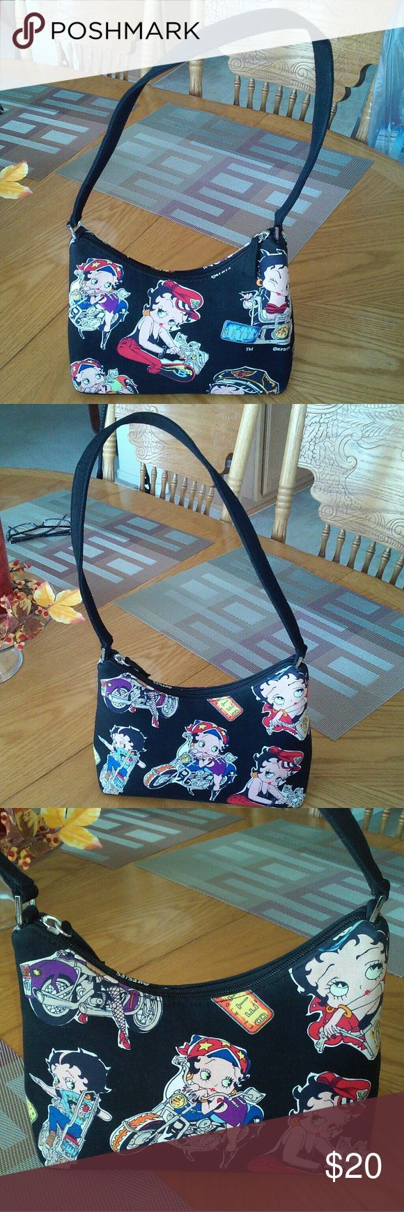 Betty Boop purse EZ Rider motorcycle VG used cond Really cute Betty Boop purse in very good condition. Measures 9 inches by 7 inches and strap is 22 inches long. This is EZ Rider Betty with her motorcycle. Bag has 2 small pockets inside. Bags