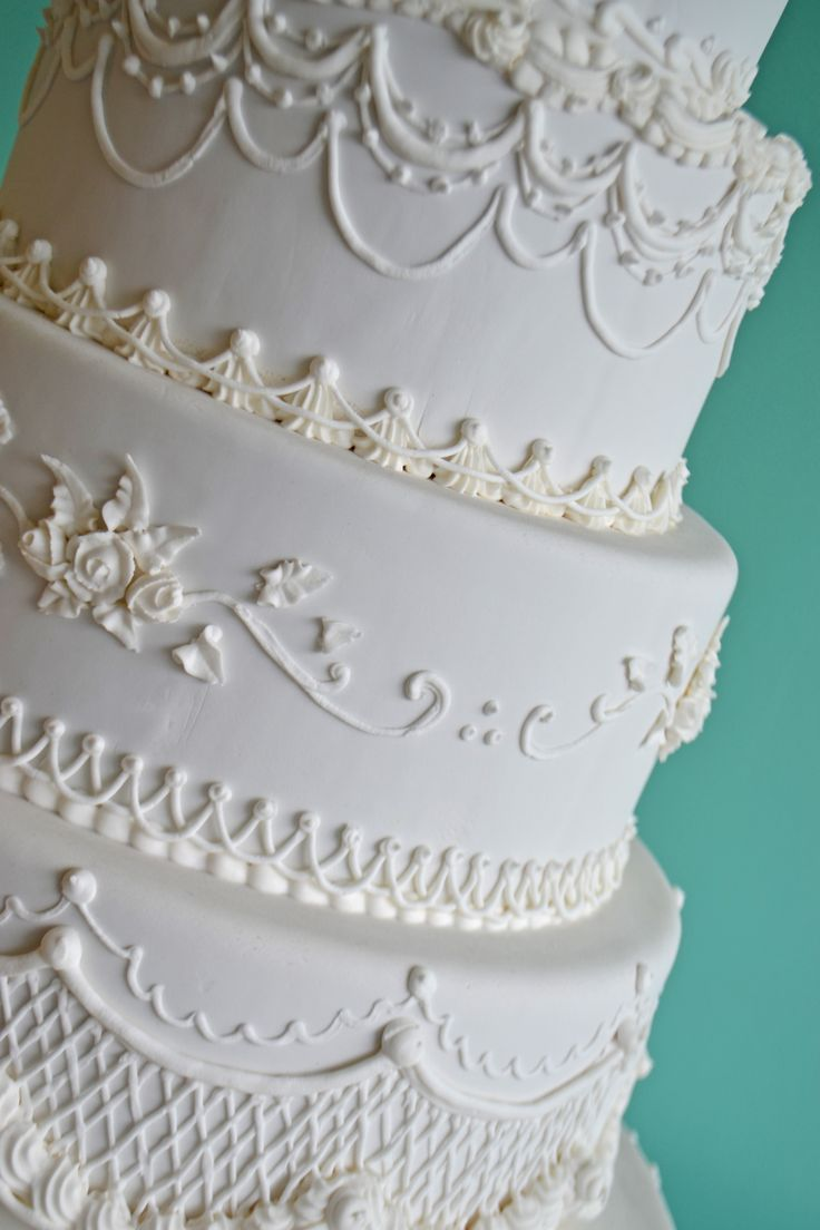 Elegant white-on-white wedding cake by Bake Sale.