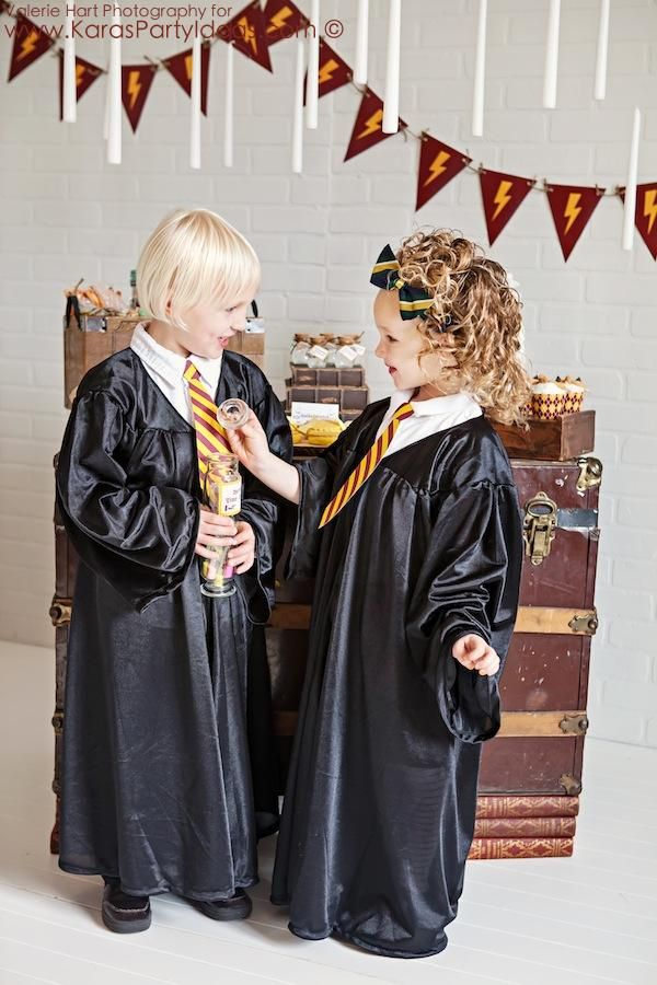Gowns: Inexpensive children's graduation gowns look just like Hogwarts gowns! A gown was given to each child as they arrived at the party. The gowns are available in the Kara's Party Ideas online shop here.