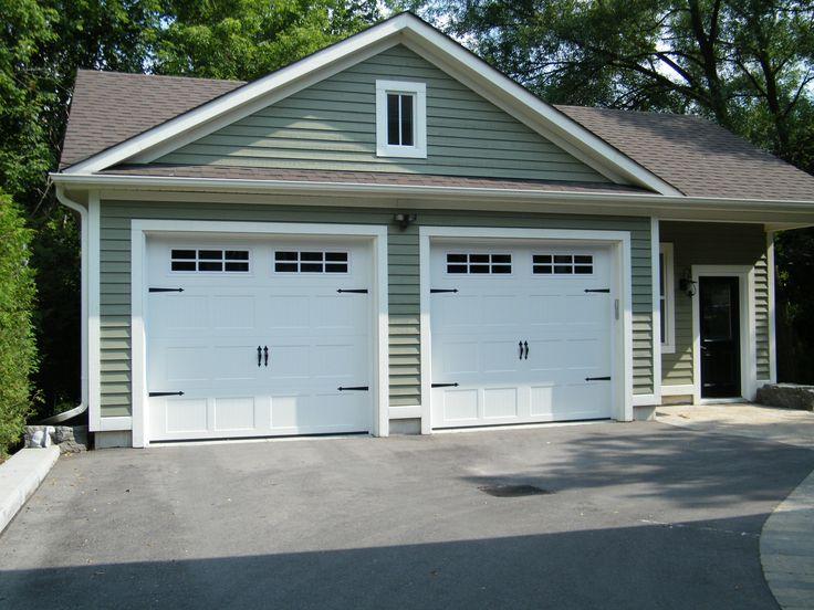 Black Pergola Over Garage Door
