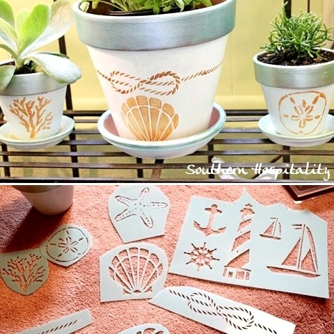 Beach and nautical theme terracotta pots. How to paint and stencil terra cotta pots.