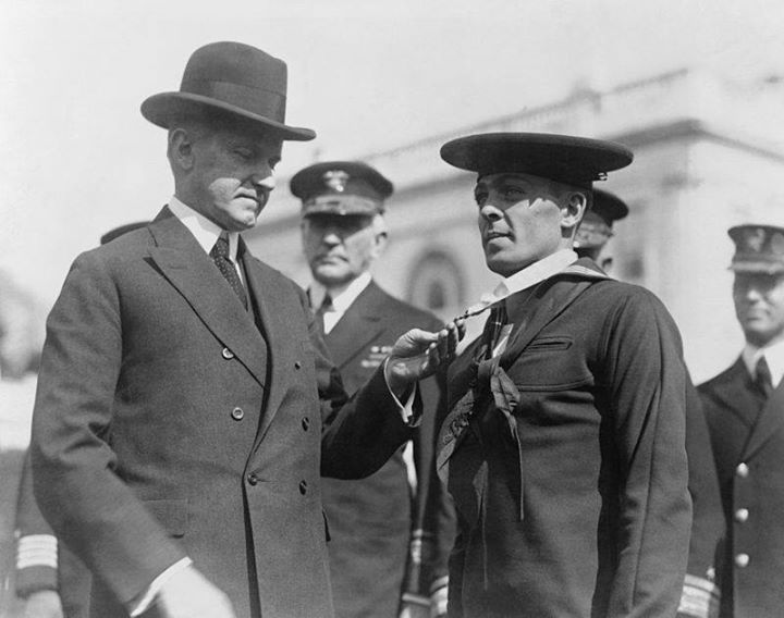 President Calvin Coolidge bestowing the Medal of Honor upon Henry Breault March 8 1924.