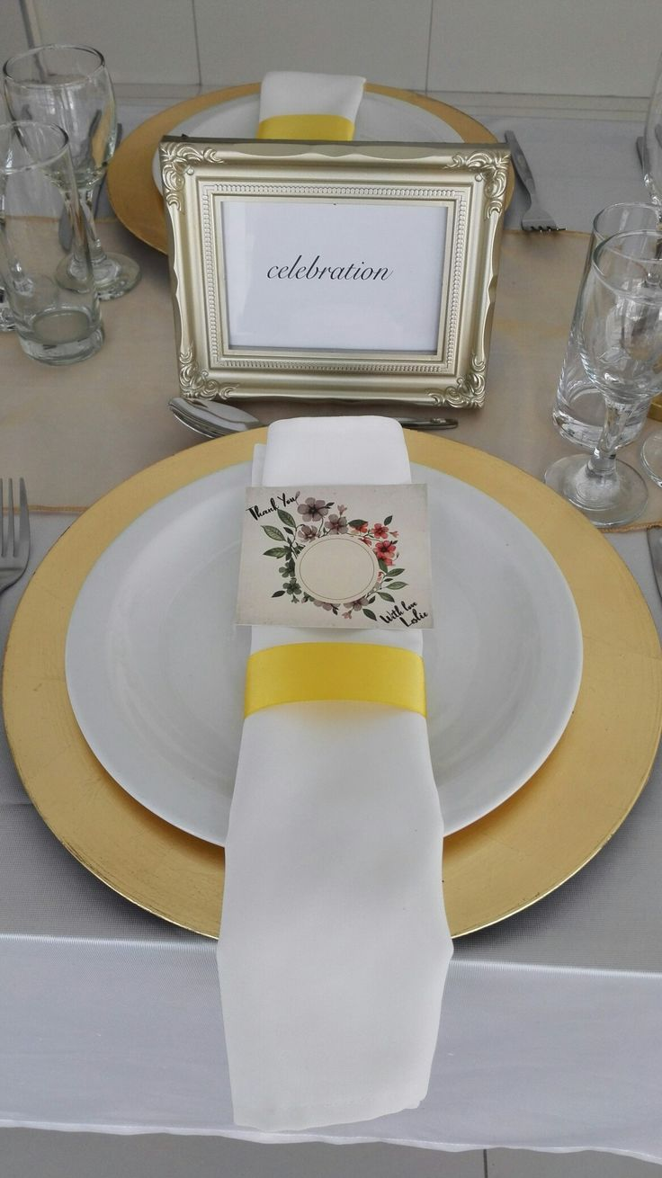 White, gold and greenery. Gold charger plate. White napkin. elegant table setting ideas. Gold frames. Gold table decor ideas
