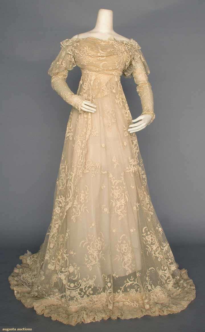 LACE WEDDING GOWN, PARIS, c. 1910 Ecru cotton net w/ Brussels lace applique, 1-piece, empire, trained skirt, petersham stamped