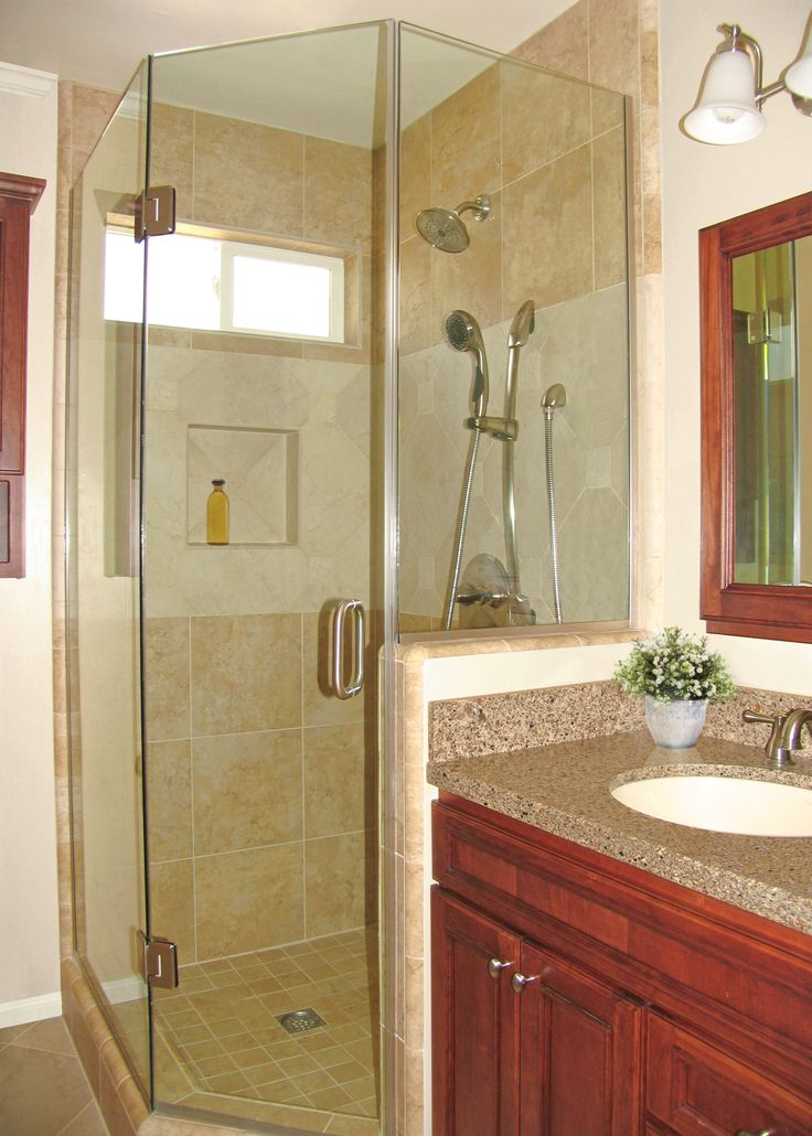 a corner shower maximizes the footage in this bathroom remodel
